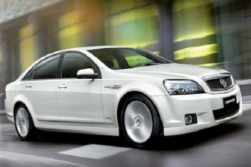 2 B Chauffeured fleet cars: White Caprice.