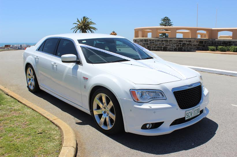 2 B Chauffeured fleet cars: White Chrysler.